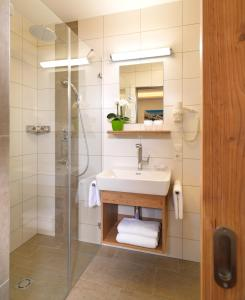 Ein Badezimmer in der Unterkunft Sporthotel Schieferle