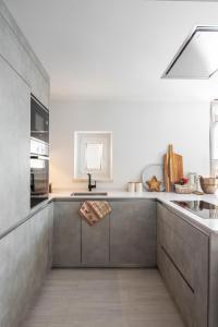 A kitchen or kitchenette at Baqueira-Beret ERA CABANA, Salardu+Parking Val de Ruda