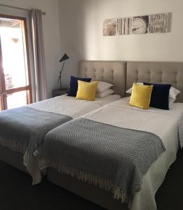 A bed or beds in a room at The Hideaway Agnes Water (Adults Only)