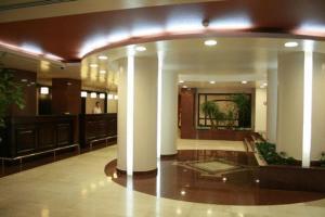 The lobby or reception area at Hotel Rapsodia City Center