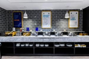 A kitchen or kitchenette at Holiday Inn Express - Wigan, an IHG Hotel