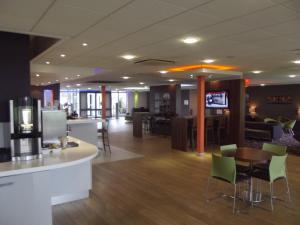 The lounge or bar area at Holiday Inn Express Preston South, an IHG Hotel