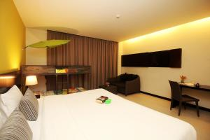 A bed or beds in a room at Simplitel