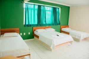 Cama o camas de una habitación en Hotel Dez De Julho