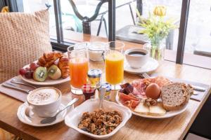 Opções de café da manhã disponíveis para hóspedes em Hotel 29 Lepic