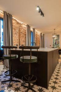 A kitchen or kitchenette at NEW SOHO by STAYNN APARTMENTS