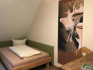 A bed or beds in a room at Landhaus Krone