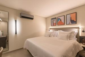 A bed or beds in a room at Royal Jardins Boutique Hotel