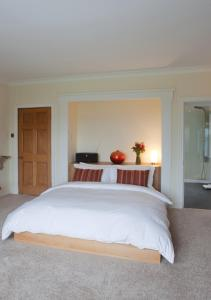 A bed or beds in a room at Sturmer Hall Hotel and Conference Centre