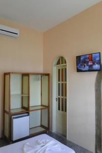 A television and/or entertainment center at Hotel Ilhéus