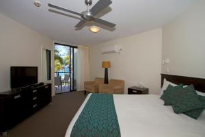 A bed or beds in a room at The Beach Retreat Coolum