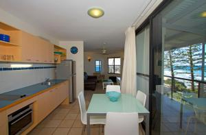A kitchen or kitchenette at The Beach Retreat Coolum