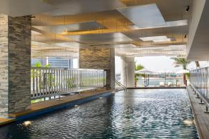 The swimming pool at or near Park Regis Business Bay