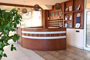 The lobby or reception area at Harmony Hotel