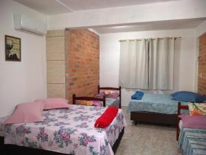 Cama ou camas em um quarto em Canto da Praia