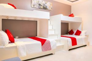 Litera o literas de una habitación en OYO 484 Gonzala Suites