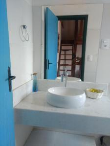 Um banheiro em Pousada Recanto de Minas