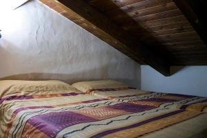 Cama o camas de una habitación en Casas Rurales Quijote y Sancho