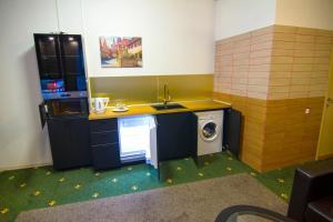 Кухня или мини-кухня в HF Hotel