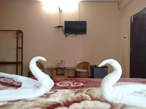 A bed or beds in a room at The Shire Kalimpong