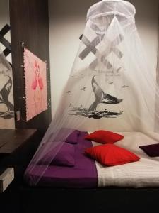 Ein Bett oder Betten in einem Zimmer der Unterkunft Agosto Guest House