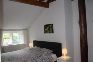 A bed or beds in a room at B&B Heida