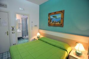 Cama ou camas em um quarto em Villa Adriana Amalfi