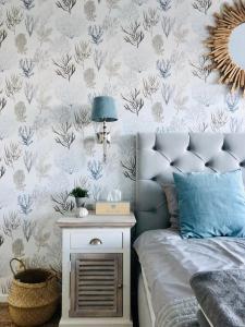 Łóżko lub łóżka w pokoju w obiekcie Biały Apartament Hampton w Playa Baltis