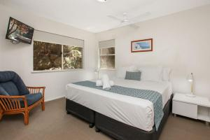 A bed or beds in a room at Lennox Beach Resort