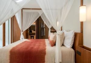 A bed or beds in a room at Bisma Eight