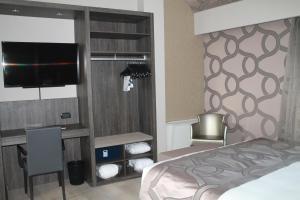 Postel nebo postele na pokoji v ubytování Hotel Mozart