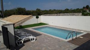 A view of the pool at Holiday Home Luka or nearby