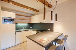 Küche/Küchenzeile in der Unterkunft Hotel Hubertus mit Erlebnislandgasthof Reitherwirt