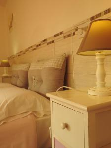 A bed or beds in a room at Geoglobe Chambre d'hotes