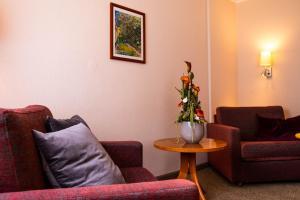 Ein Sitzbereich in der Unterkunft Bundt's Hotel & Gartenrestaurant