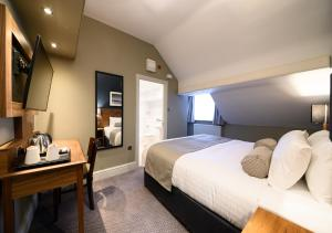 A bed or beds in a room at Innkeeper's Collection Lytham St Annes