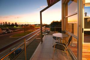 A balcony or terrace at Semaphore Blue Apartments