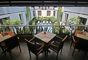 A balcony or terrace at The Legian Sunset Residence