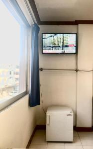 A television and/or entertainment center at At Bangkok Hotel