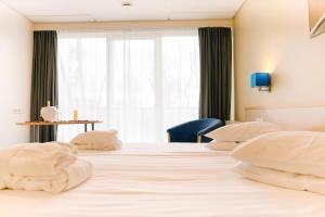 Voodi või voodid majutusasutuse Spa Hotel Rüütli toas