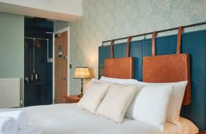 A bed or beds in a room at The Angel Inn Hotel