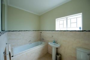 A bathroom at Brolly Apartments