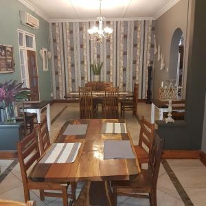 A restaurant or other place to eat at Stoep At Steenbok Self Catering