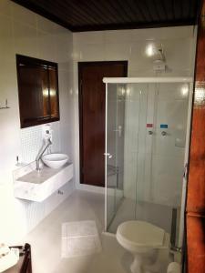 Um banheiro em Pousada Casarão