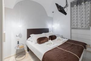 Letto o letti in una camera di Aventino Perfect Suite