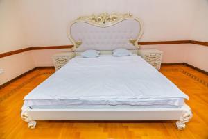 Cama ou camas em um quarto em Hard Rock Building Apartment by Time Group