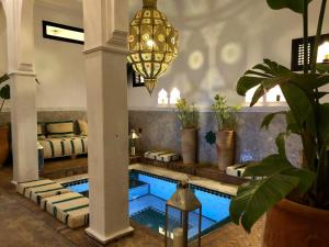 The swimming pool at or close to Riad Chafia