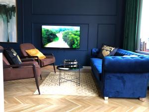 A seating area at Apartamenty Royal Point Bed & Bath