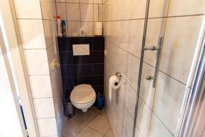 Ванная комната в Hotel Gasterij in het Gouden Hoefijzer