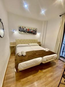 A bed or beds in a room at Da Vinci Boutique